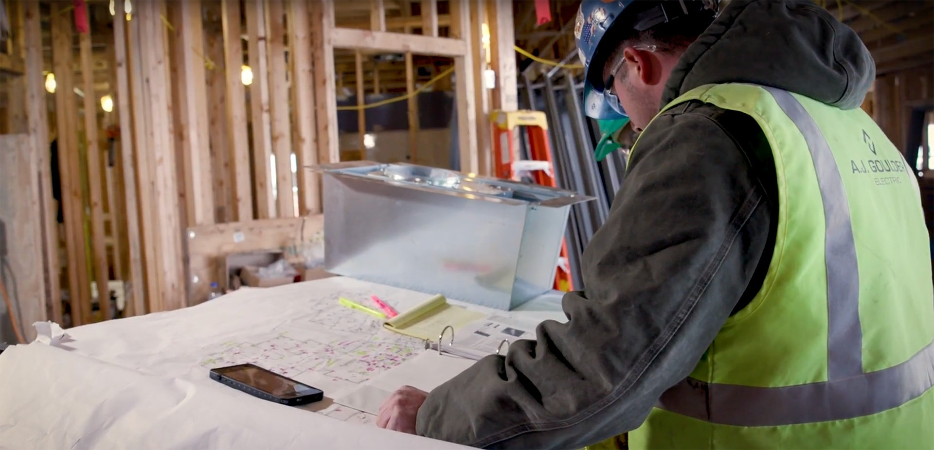 Image of electrical worker planning